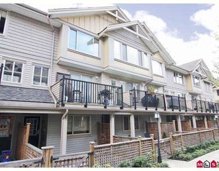 "Photo 1: 24 5388 201A Street in Langley: Langley City Townhouse for sale in ""THE COURTYARD"" : MLS®# F2812450"