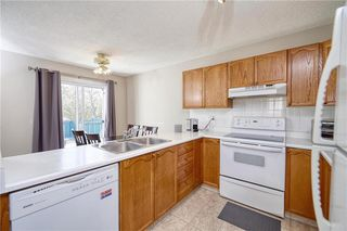 Photo 3: 75 MILLRISE Crescent SW in Calgary: Millrise Detached for sale : MLS®# C4299889
