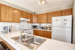 Photo 4: 75 MILLRISE Crescent SW in Calgary: Millrise Detached for sale : MLS®# C4299889