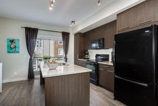 Photo 8: 122 2802 Kings Heights Gate SE: Airdrie Row/Townhouse for sale : MLS®# A1041421