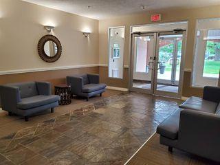 Photo 3: 7107 14 HEMLOCK Crescent SW in Calgary: Spruce Cliff Apartment for sale : MLS®# C4302638