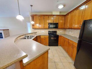 Photo 6: 7107 14 HEMLOCK Crescent SW in Calgary: Spruce Cliff Apartment for sale : MLS®# C4302638