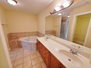 Photo 18: 7107 14 HEMLOCK Crescent SW in Calgary: Spruce Cliff Apartment for sale : MLS®# C4302638