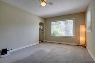 Photo 9: 824 19 Avenue NW in Calgary: Mount Pleasant Detached for sale : MLS®# A1009057