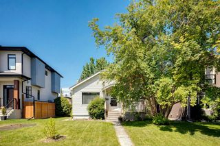 Photo 1: 824 19 Avenue NW in Calgary: Mount Pleasant Detached for sale : MLS®# A1009057