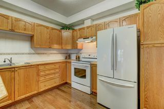 Photo 13: 110 223 Tuscany Springs Boulevard NW in Calgary: Tuscany Apartment for sale : MLS®# A1038824