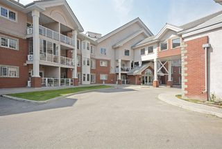 Photo 1: 110 223 Tuscany Springs Boulevard NW in Calgary: Tuscany Apartment for sale : MLS®# A1038824