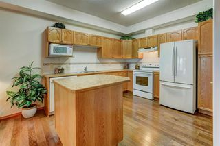 Photo 11: 110 223 Tuscany Springs Boulevard NW in Calgary: Tuscany Apartment for sale : MLS®# A1038824