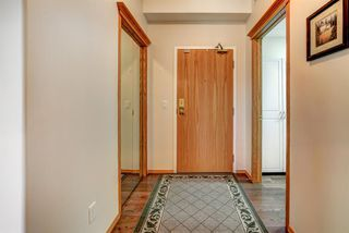 Photo 3: 110 223 Tuscany Springs Boulevard NW in Calgary: Tuscany Apartment for sale : MLS®# A1038824