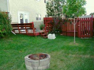 Photo 7: 251 GLENPATRICK Drive: Cochrane Duplex Side By Side for sale : MLS®# C3180503