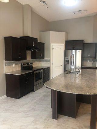 Photo 5: 3 2815 34 Avenue in Edmonton: Zone 30 House Half Duplex for sale : MLS®# E4172726