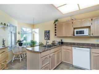 "Photo 3: 13 19649 53 Avenue in Langley: Langley City Townhouse for sale in ""Huntsfield Green"" : MLS®# R2412498"