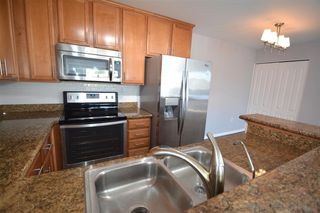 Photo 8: SERRA MESA Condo for sale : 2 bedrooms : 3454 Castle Glen Dr #235 in San Diego