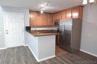 Photo 7: SERRA MESA Condo for sale : 2 bedrooms : 3454 Castle Glen Dr #235 in San Diego