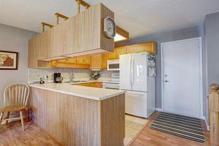 Photo 9: 4 COACH SIDE Terrace SW in Calgary: Coach Hill Semi Detached for sale : MLS®# A1037354