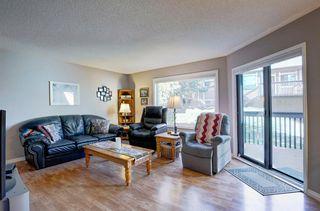 Photo 3: 4 COACH SIDE Terrace SW in Calgary: Coach Hill Semi Detached for sale : MLS®# A1037354