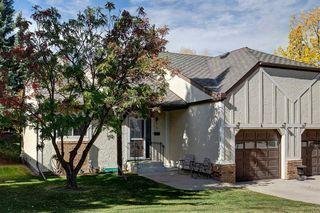 Photo 2: 4 COACH SIDE Terrace SW in Calgary: Coach Hill Semi Detached for sale : MLS®# A1037354