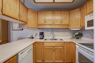 Photo 11: 4 COACH SIDE Terrace SW in Calgary: Coach Hill Semi Detached for sale : MLS®# A1037354