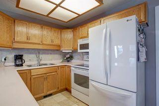 Photo 10: 4 COACH SIDE Terrace SW in Calgary: Coach Hill Semi Detached for sale : MLS®# A1037354