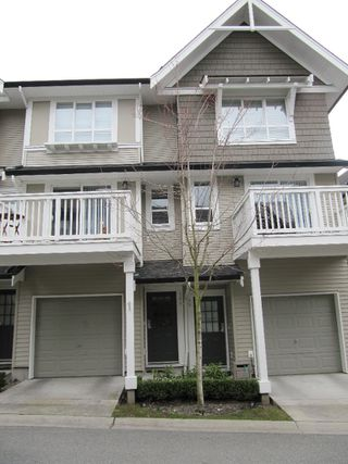 "Photo 1: 100 6747 203RD Street in Langley: Townhouse for sale in ""Willoughby Heights"" : MLS®# F1107665"