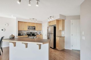 Photo 10: 567 PANAMOUNT Boulevard NW in Calgary: Panorama Hills Semi Detached for sale : MLS®# A1047979