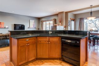 Photo 9: 30 Cougarstone Mews SW in Calgary: Cougar Ridge Detached for sale : MLS®# A1053099