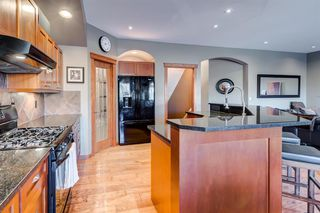Photo 8: 30 Cougarstone Mews SW in Calgary: Cougar Ridge Detached for sale : MLS®# A1053099