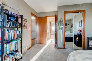 Photo 24: 30 Cougarstone Mews SW in Calgary: Cougar Ridge Detached for sale : MLS®# A1053099