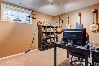 Photo 33: 30 Cougarstone Mews SW in Calgary: Cougar Ridge Detached for sale : MLS®# A1053099