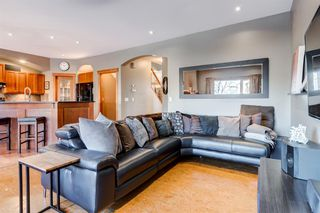 Photo 10: 30 Cougarstone Mews SW in Calgary: Cougar Ridge Detached for sale : MLS®# A1053099