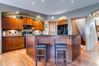 Photo 6: 30 Cougarstone Mews SW in Calgary: Cougar Ridge Detached for sale : MLS®# A1053099