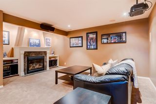 Photo 31: 30 Cougarstone Mews SW in Calgary: Cougar Ridge Detached for sale : MLS®# A1053099