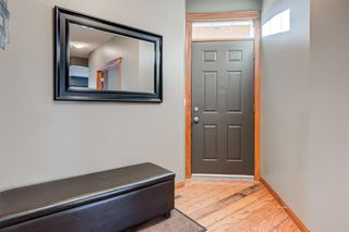 Photo 3: 30 Cougarstone Mews SW in Calgary: Cougar Ridge Detached for sale : MLS®# A1053099