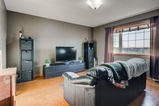 Photo 16: 30 Cougarstone Mews SW in Calgary: Cougar Ridge Detached for sale : MLS®# A1053099