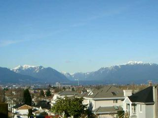 Photo 5: 5065 INVERNESS ST in Vancouver: Knight House for sale (Vancouver East)  : MLS®# V580971