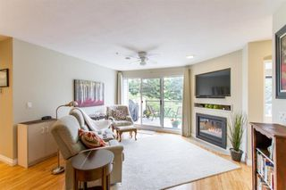 "Photo 1: 307 20976 56 Avenue in Langley: Langley City Condo for sale in ""Riverwalk"" : MLS®# R2464309"