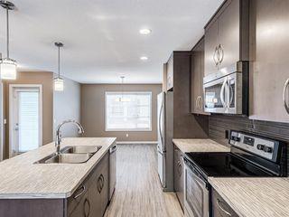 Photo 6: 207 Evansridge Park NW in Calgary: Evanston Row/Townhouse for sale : MLS®# A1048385