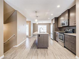 Photo 4: 207 Evansridge Park NW in Calgary: Evanston Row/Townhouse for sale : MLS®# A1048385