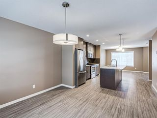 Photo 10: 207 Evansridge Park NW in Calgary: Evanston Row/Townhouse for sale : MLS®# A1048385