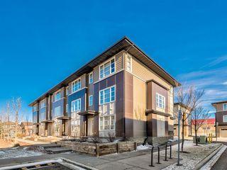 Photo 2: 207 Evansridge Park NW in Calgary: Evanston Row/Townhouse for sale : MLS®# A1048385