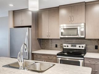 Photo 7: 207 Evansridge Park NW in Calgary: Evanston Row/Townhouse for sale : MLS®# A1048385