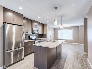 Photo 9: 207 Evansridge Park NW in Calgary: Evanston Row/Townhouse for sale : MLS®# A1048385