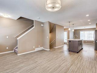 Photo 8: 207 Evansridge Park NW in Calgary: Evanston Row/Townhouse for sale : MLS®# A1048385
