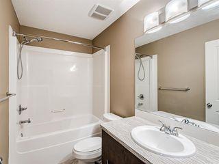 Photo 31: 207 Evansridge Park NW in Calgary: Evanston Row/Townhouse for sale : MLS®# A1048385