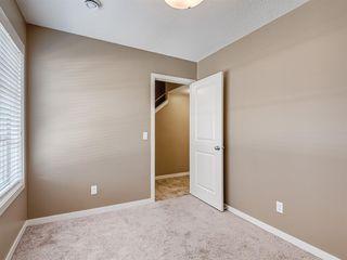 Photo 13: 207 Evansridge Park NW in Calgary: Evanston Row/Townhouse for sale : MLS®# A1048385