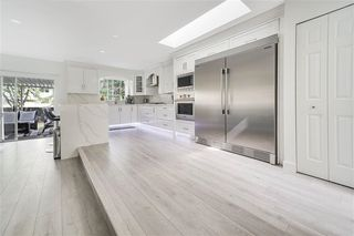 Photo 5: 15569 94 Avenue in Surrey: Fleetwood Tynehead House for sale : MLS®# R2411840