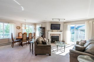 "Photo 1: 408 20433 53 Avenue in Langley: Langley City Condo for sale in ""COUNTRYSIDE ESTATES"" : MLS®# R2492366"