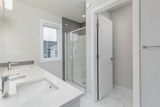 Photo 14: 153 Crestridge Common SW in Calgary: Crestmont Row/Townhouse for sale : MLS®# A1051009