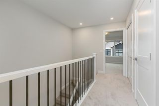 Photo 18: 153 Crestridge Common SW in Calgary: Crestmont Row/Townhouse for sale : MLS®# A1051009