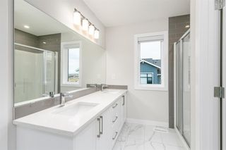 Photo 12: 153 Crestridge Common SW in Calgary: Crestmont Row/Townhouse for sale : MLS®# A1051009